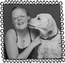 Black and white photo of Sammy Loewi, the author's daughter, as a child, being kissed by her dog. There is a fun illustration frame around the image made of hand drawn loops.